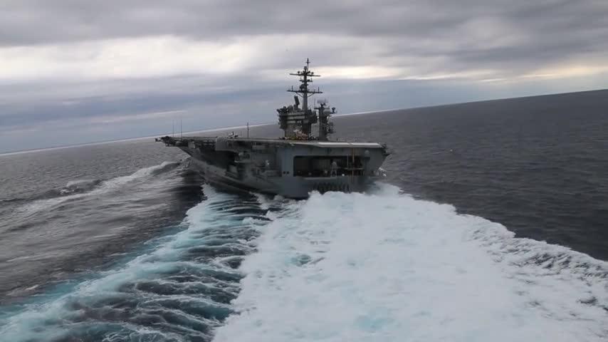 Nimitz-class aircraft carrier USS Abraham Lincoln (CVN 72) performs high-speed turns in the Atlantic Ocean